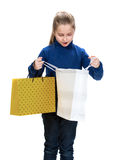 Pretty small girl with shopping bags Stock Photo