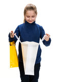 Pretty small girl with shopping bags Royalty Free Stock Photography