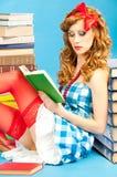 Pretty smart beautiful pin up  girl reads book Stock Photos