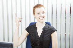 Pretty businesswoman pointing above her head Stock Photography