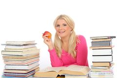 Pretty smart woman with lots of books study Royalty Free Stock Photo