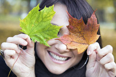 Pretty Smile And Colorful Leaves Stock Photography