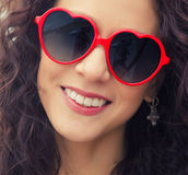 Pretty smile and heart shape glasses Stock Image