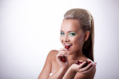 Happy smile woman eat red cherry Stock Image