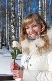 Pretty young woman with rose , winter season Stock Photos