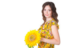 Pretty smiley girl with sunflower isolated on whit Stock Photography