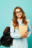 Pretty smiley girl wearing glasses pretty student holding books. Pretty girl wearing glasses pretty student holding books and wearing glasses Royalty Free Stock Photos