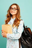 Pretty smiley girl wearing glasses pretty student holding books. Pretty girl wearing glasses pretty student holding books and wearing glasses Stock Image