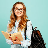 Pretty smiley girl wearing glasses pretty student holding books. Pretty girl wearing glasses pretty student holding books and wearing glasses Stock Images