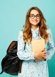 Pretty smiley girl wearing glasses pretty student holding books. Pretty girl wearing glasses pretty student holding books and wearing glasses Royalty Free Stock Image