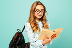 Pretty smiley girl wearing glasses pretty student holding books. Pretty girl wearing glasses pretty student holding books and wearing glasses Stock Photos