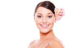 Pretty smiley model with rose in hair Stock Photos