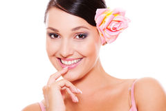Pretty smiley model with rose in hair Stock Photo