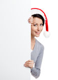 Pretty smiley woman in Christmas red cap Royalty Free Stock Images