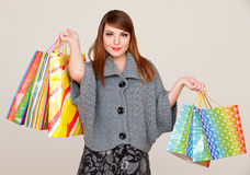 Pretty smiley woman with shopping bags Royalty Free Stock Photo