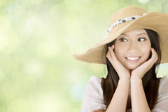Pretty smiling asian woman with hat Stock Image