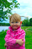 Pretty smiling baby girl with nice plaits Stock Photography
