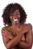 Pretty Smiling black woman bare top covered Stock Photo