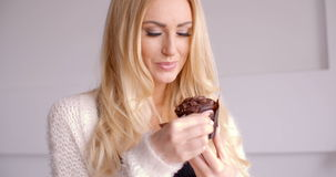 Pretty Smiling Blond Woman with Chocolate Cupcake stock video footage