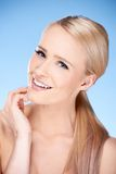 Pretty Smiling Blond Woman Hand Touching Face Royalty Free Stock Photos