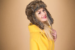 Pretty smiling blond woman in a winter hat Stock Image