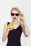 Pretty smiling blonde woman in sunglasses with cocktail. Portrait of pretty smiling blonde woman in sunglasses with cocktail Royalty Free Stock Photos
