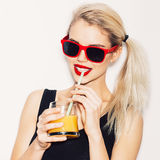 Pretty smiling blonde woman in sunglasses with cocktail Royalty Free Stock Image