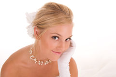 Pretty smiling bride. Portrait of smiling young blond bride, isolated on white background Royalty Free Stock Photo
