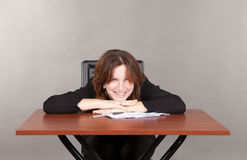 Pretty smiling business woman sitting at the table Stock Photos