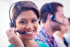 Pretty smiling businesswoman working in a call centre Stock Image