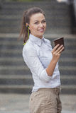 Pretty Smiling Caucasian Brunette Woman With Headphones and Chatting on Cellphone Stock Photos