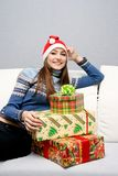 Pretty smiling caucasian girl in santa hat Stock Images