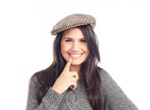 Pretty smiling and cheerful brunette woman with a french cap and a wool sweater royalty free stock image