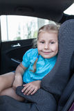 Pretty smiling child in car safety seat Royalty Free Stock Image
