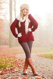 Pretty smiling fashion woman in fur winter hat. Royalty Free Stock Photos