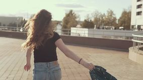 Beautiful brunette girl running at sunset outdoors in slow motion stock video footage