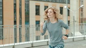 Pretty smiling fitness woman using running app before the run for track the pace on smartwatch, happy smiling sportive stock footage