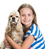 Pretty smiling girl with american spaniel Stock Image