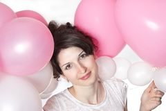 Pretty smiling girl with balloons Stock Images
