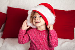 Pretty smiling girl in the cap of Santa Claus Stock Images