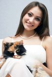 Pretty smiling girl with cat Stock Photo