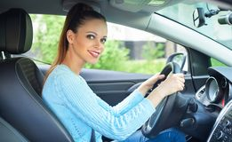 Pretty smiling girl driving a car Stock Photography