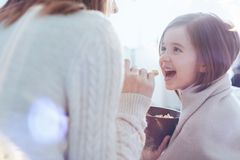 Pretty smiling girl eating her breakfast stock photography