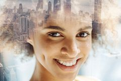 Pretty smiling girl expressing happiness and pleasure Royalty Free Stock Photography