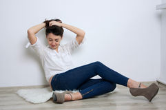 Pretty smiling girl on the floor Stock Image