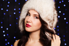 Pretty smiling girl in a furry winter hat. Beautiful young girl in a furry winter hat Stock Images