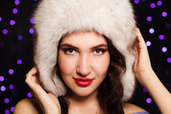 Pretty smiling girl in a furry winter hat Stock Photo