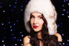 Pretty smiling girl in a furry winter hat Stock Photos