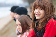 Pretty Smiling Girl Having Fun With Friends Stock Photography