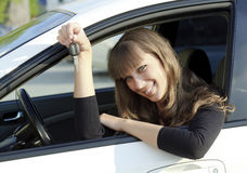 Pretty smiling girl holding car key Stock Images